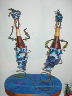 """The Dancers""    maraca shaped gourds mounted on metal springs and wood base   22""high"